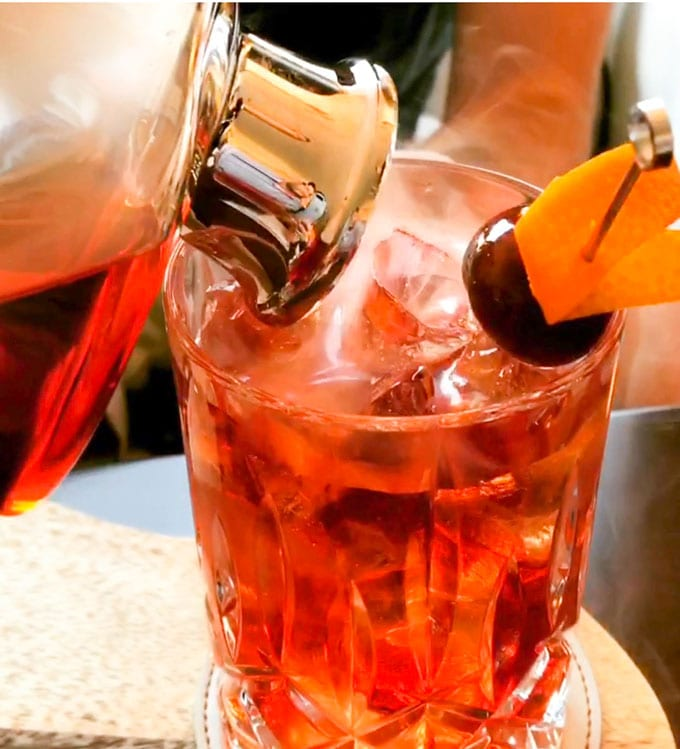 The Boulevardier is complex, refreshing and totally delicious - a fantastic drink recipe to add to your cocktail repertoire. With or without the smoke, these will be loved by all!