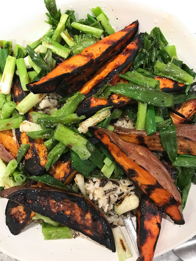 Grilled Sweet Potatoes: Here's a fabulous technique for cooking sweet potato wedges to perfection without frying them. Crisp and caramelized outside, sweet and tender inside, firm enough to hold up to a salad or to grab in hand and dip into a tasty dressing or aioli. These are some seriously great grilled sweet potatoes!