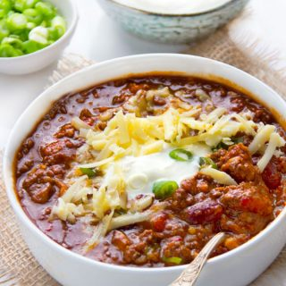 Everyone needs a great chili con carne recipe in their repertoire. This award winning chili is the best! It has a robust meaty flavor, the perfect amount of heat, beef, pork, beans, fresh chile peppers, awesome spices, onions, garlic, tomatoes and beer. So good! And It freezes well so you might want to make a double batch.