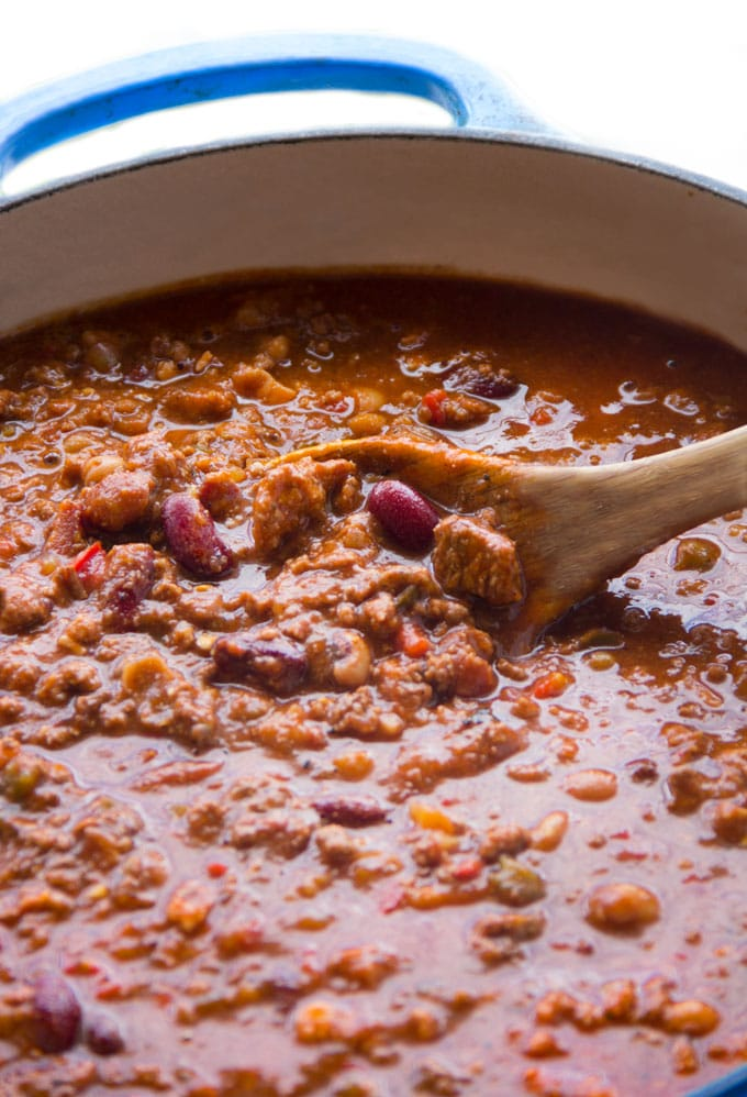 Close up of Eddie's award winning chili in a pot with a wooden spoon