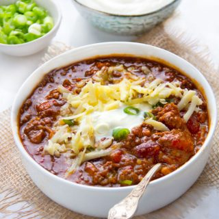 This Award Winning Chili recipe is hands down the BEST chili con carne I've ever tasted, with the most incredible flavor and texture - made with beef, pork, beans, awesome spices, onions, garlic, tomatoes and beer. Plus it freezes well so you might want to make a double batch.