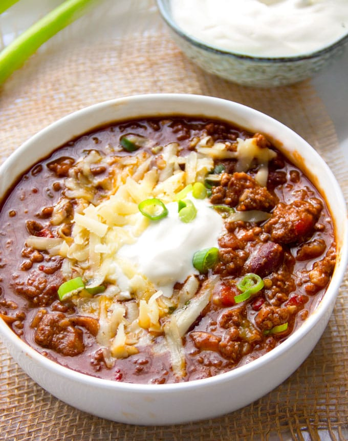 bowl of Eddie's award winning chili with toppings