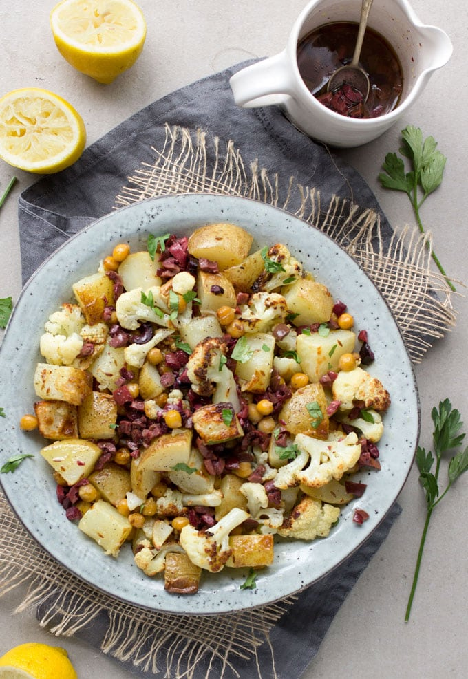 Roasted Cauliflower, Potatoes and Chickpeas tossed in a bright lemon olive vinaigrette. Serve as a side dish or vegetarian main. [gluten-free recipe]