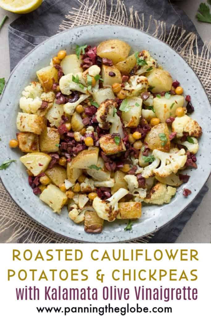 Pinterest Pin: a bowl of roasted cauliflower, potatoes and chickpeas with kalamata olive vinaigrette