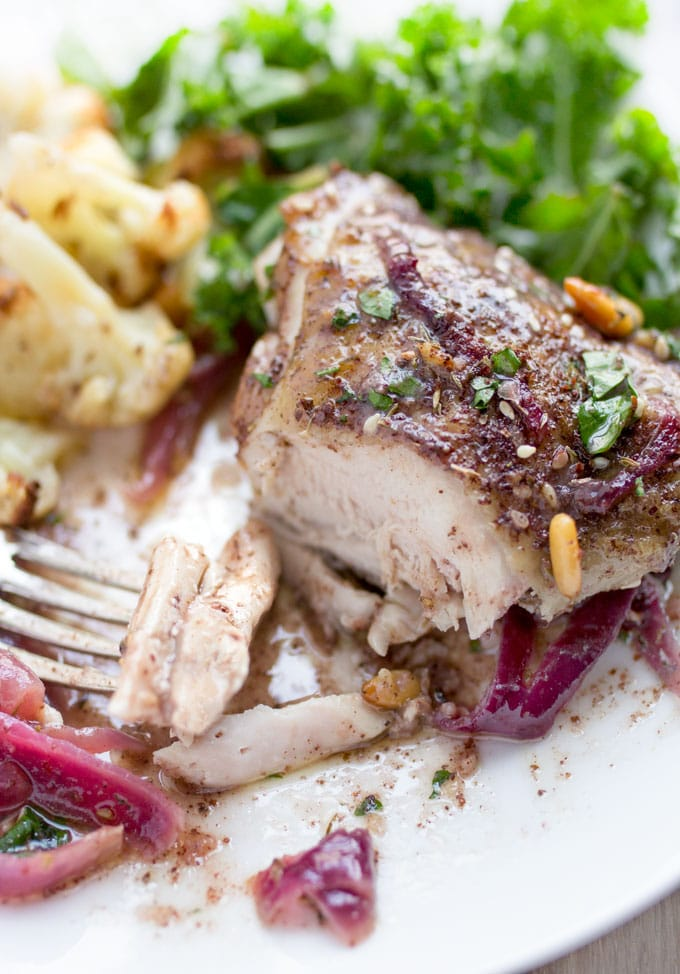 Here's an amazing roast chicken recipe from chef Yotam Ottolenghi. Chicken thighs are spiced with za'atar and sumac, tossed with onions, lemons and garlic, and roasted. This is a great dinner party recipe because it's a beautiful dish, you can do all the prep ahead, the chicken is tender and juicy, and the flavors are fantastically delicious!