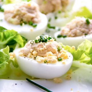 Eggs Mimosa with Tuna is a delicious French version of deviled eggs, also known as Les Oeufs Mimosa Au Thon. The recipe is easy, made with common ingredients: canned tuna, eggs, mayo, mustard and scallions. The flavors are incredible! These tasty stuffed eggs make a fantastic brunch, lunch, appetizer or game day snack.