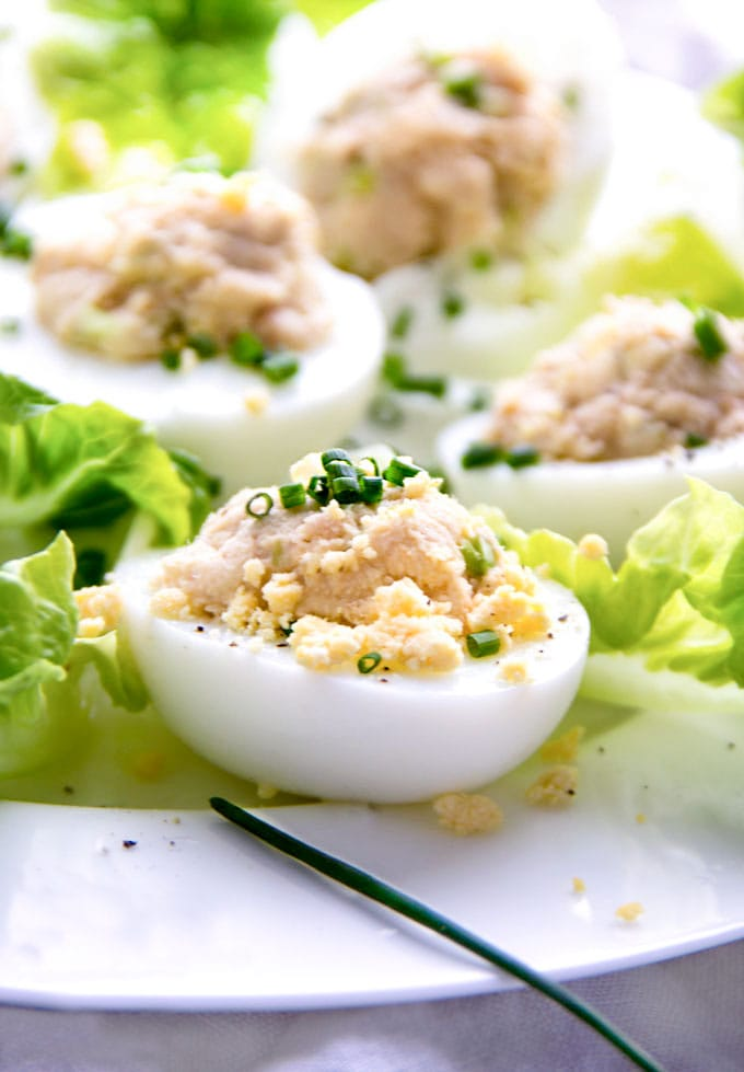 close up of 5 Deviled eggs mimosa on a bed of lettuce