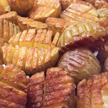 Mini inside-out hasselback potatoes are crisscross-cut mini potatoes that roast up extra golden brown and crispy on the outside and creamy inside. Whether you season these with salt and pepper or fancy them up with truffle salt and grated parmesan, they're delicious and fun and everyone will love them!