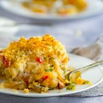 This cheesy shredded potato casserole recipe is an update on classic Funeral Potatoes, amped up on flavor with spicy chorizo, smoked paprika and sweet bell peppers, and made lighter and healthier with no canned soup and yogurt instead of sour cream l Panning The Globe