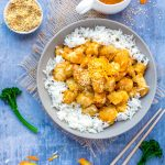 Chinese orange chicken over rice with orange sauce