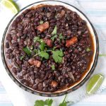 Authentic Cuban black beans are the quintessential side dish with many Latin recipes but we don't always have time to use dried beans which need an overnight soak and hours of cooking. When you want your black beans fast, this recipe will give you great tasting Cuban Black Beans in 35 minutes l www.panningtheglobe.com
