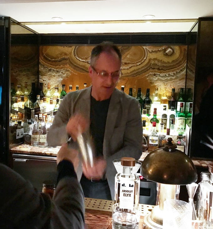 Eddie shaking up his basil vodka gimlet cocktail at Club George in London, behind the bar