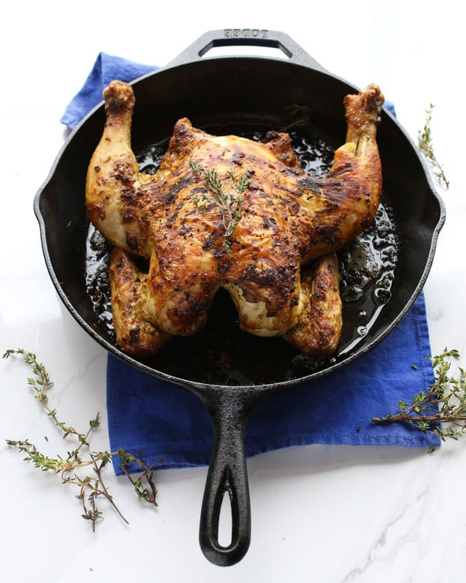 cooked roasted chicken in a skillet