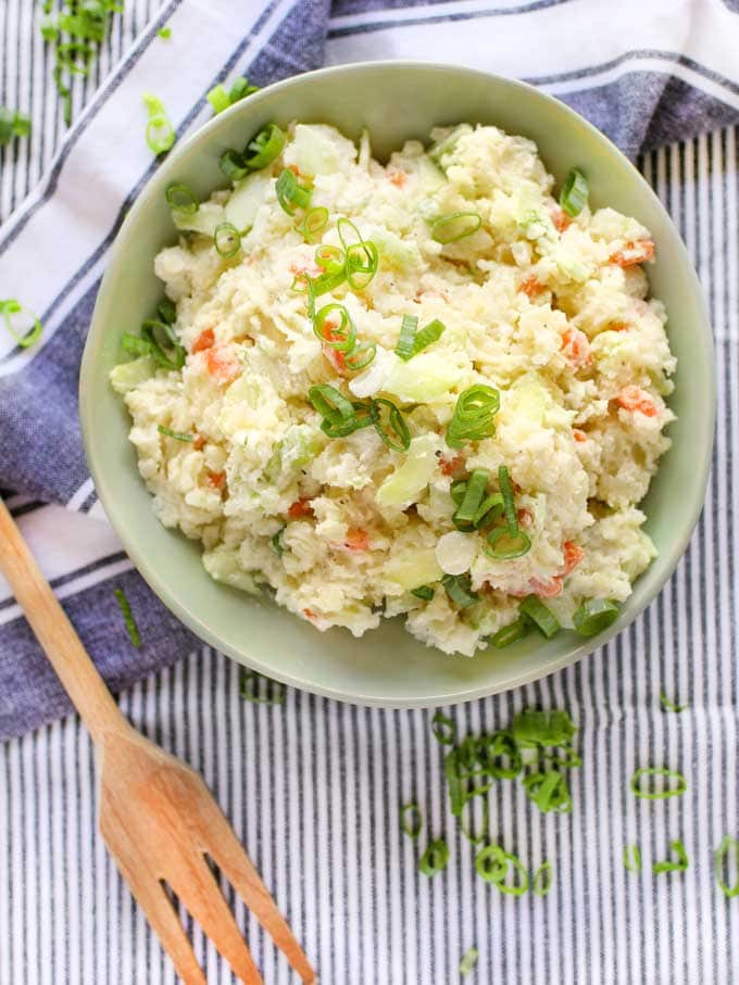 A bowl of Japanese potato salad topped with scallions