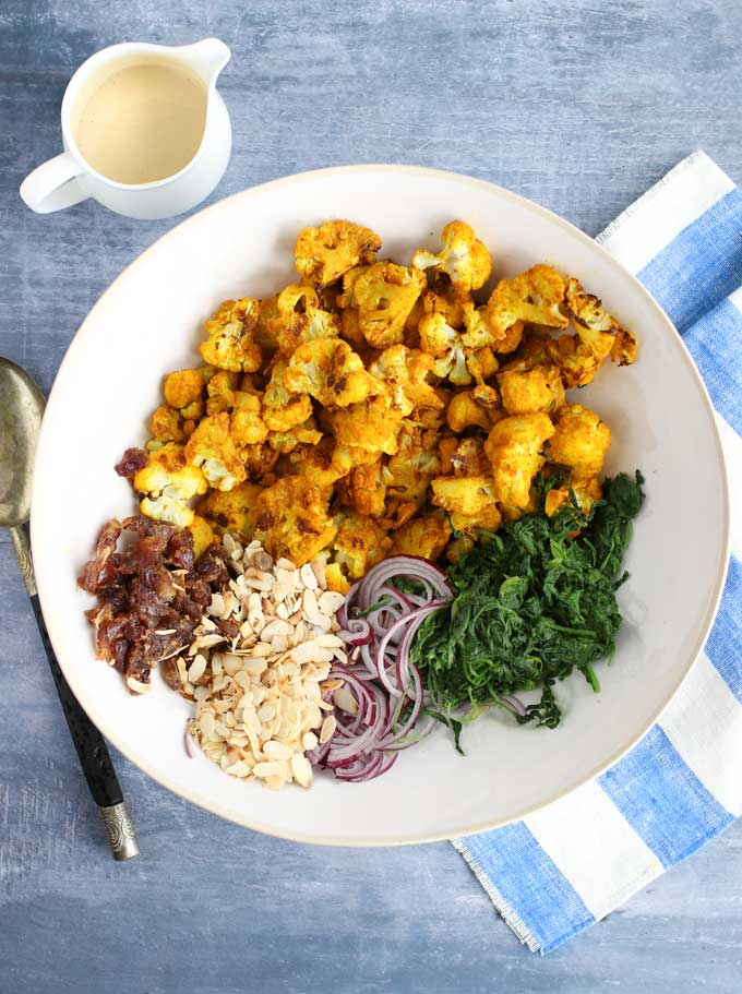 Ingredients for turmeric roasted cauliflower salad with tahini dressing