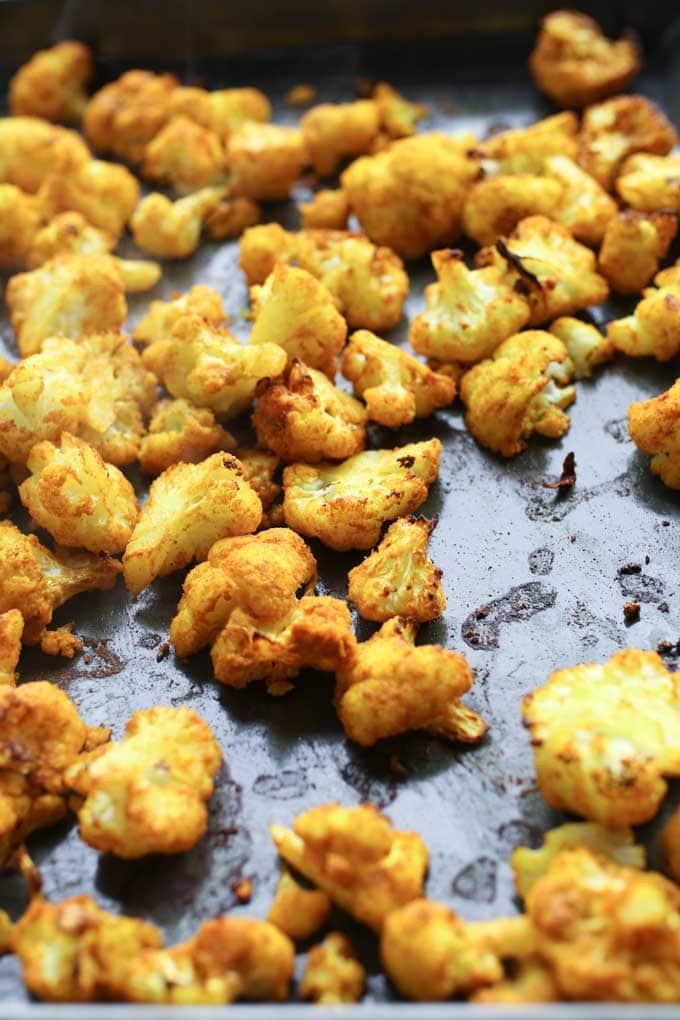 a sheet pan of turmeric roasted cauliflower florets