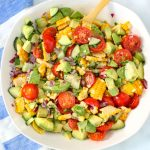 A bowl of corn tomato avocado salad