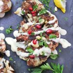 cauliflower shawarma with tahini sauce and pomegranate seeds