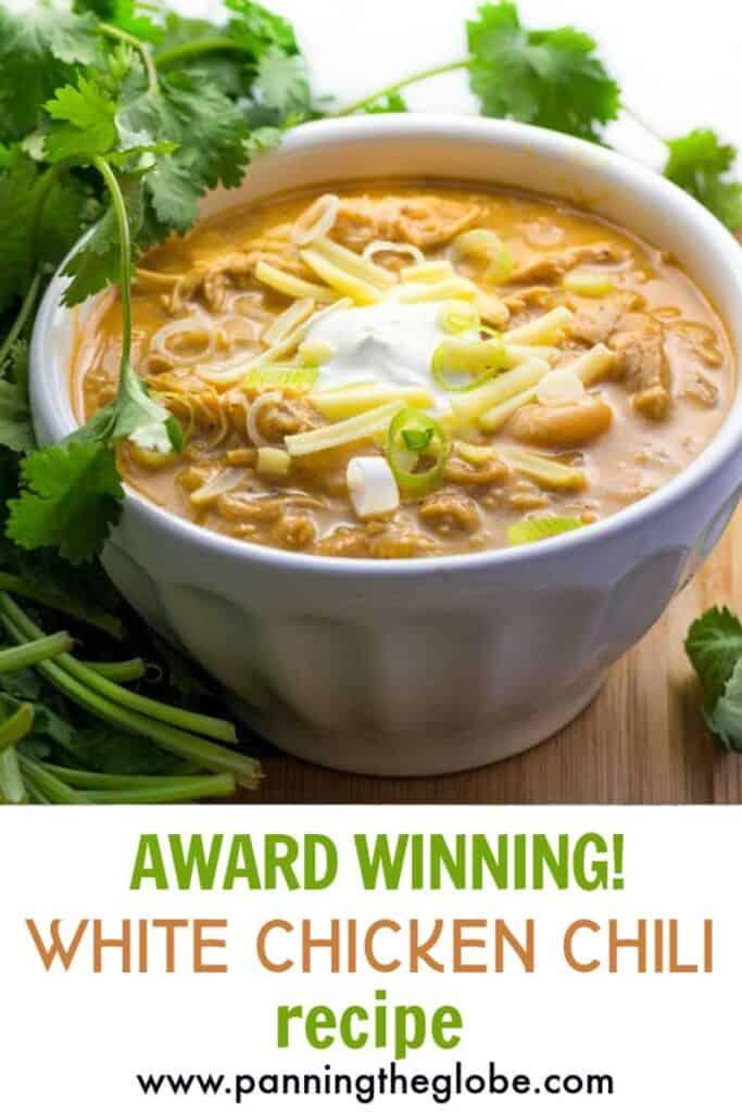 pinterest pin: award winning white chicken chili in a white bowl