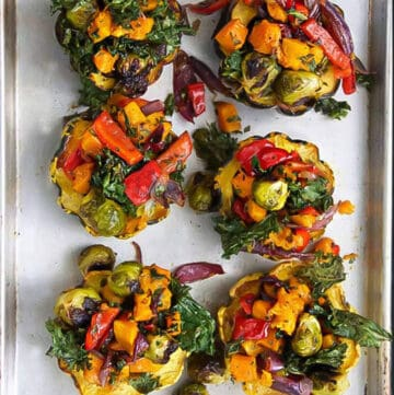 6 roasted squash halves stuffed with a rainbow of roasted fall vegetables.