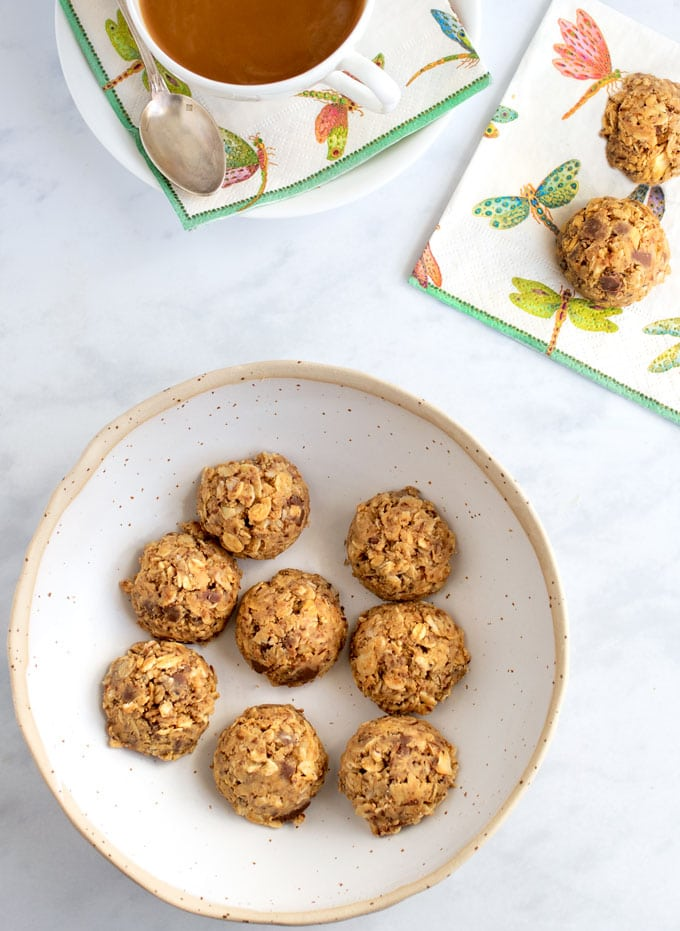 a bowl of no bake oatmeal peanut butter energy bites and a cup of coffee