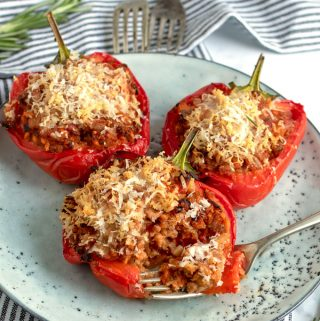 3 pork-stuffed peppers on a light blue plate