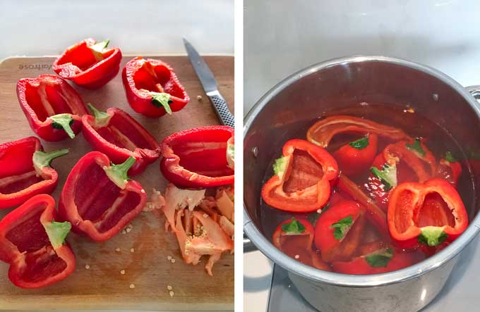 several halved red peppers on a cutting board and a pot of water with red pepper halves
