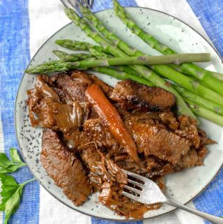 Nach Wasman's brisket, coated with tomato paste and cooked with lots of onions, is exceptionally tender and flavorful, and the recipe is surprisingly easy. #Brisket #BraisedBrisket #Beef