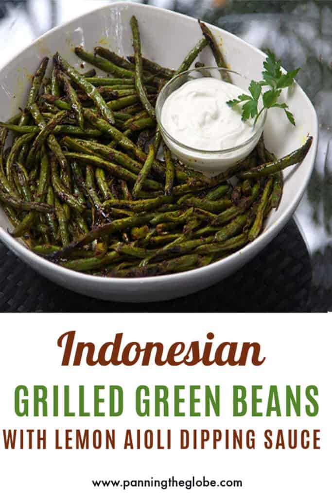 Pinterest Pin: grilled green beans in a white serving bowl with a small bowl of lemon aioli