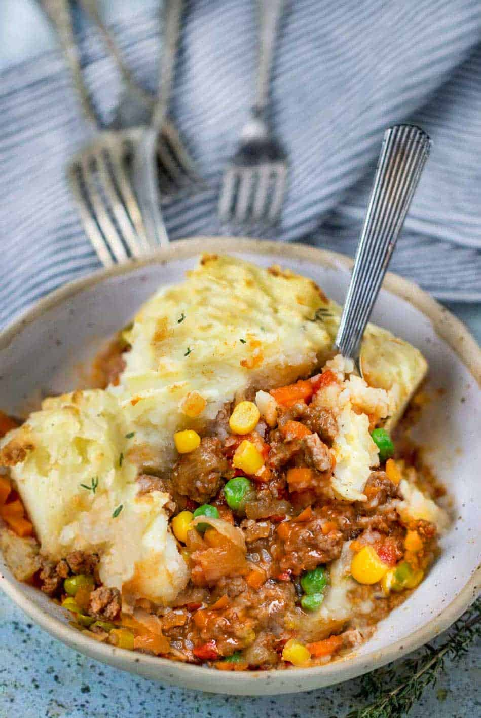 bowl of healthy shepherd's pie with forks pointing to it