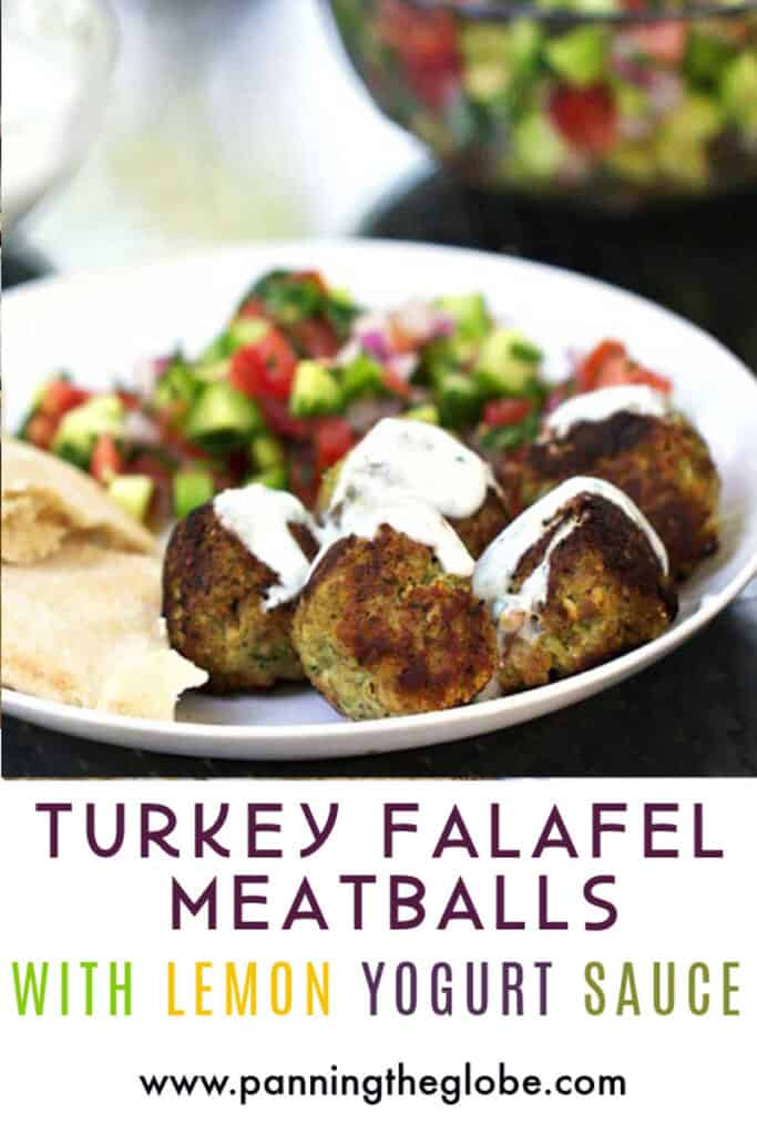 a white plate with 5 turkey falafel meatballs drizzled with lemon yogurt sauce, some chopped Israeli salad and a piece of pita bread