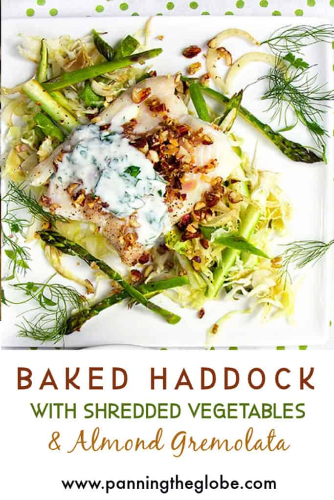 baked haddock fillet on a bed of shredded vegetables topped with yogurt sauce and almond gremolata