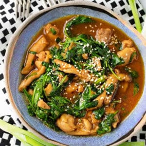 blue bowl filled with Korean chicken stew with spinach