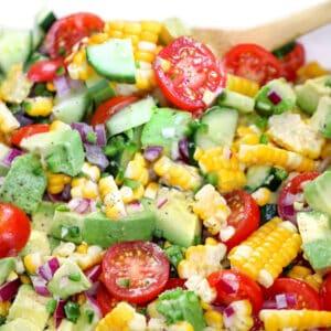 close up of corn, tomato, avocado, cucumber salad