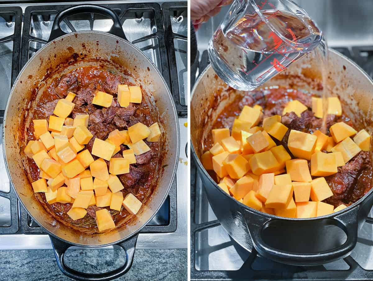 braised short ribs in a dutch oven with raw cubed butternut squash added to the pot and water being poured in from a glass measuring cup